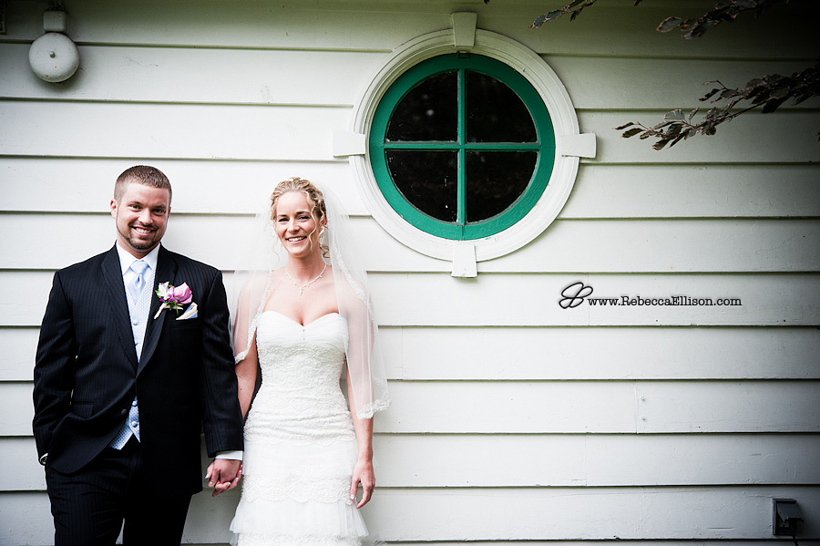 Wedding portraits at the MonteVilla Farmhouse bride and groom in front of a circular window photographed by Bothell wedding photographer Rebecca Ellison