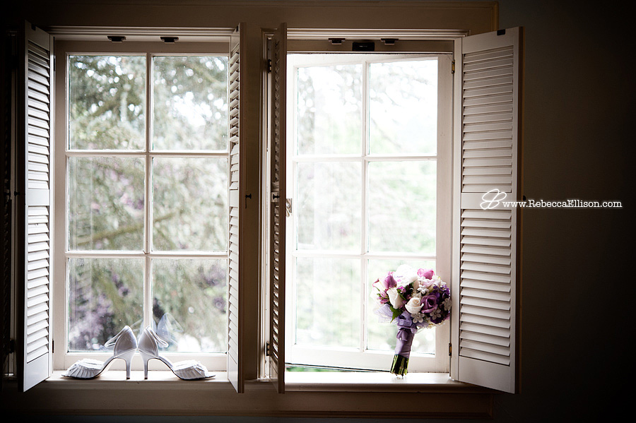 Bridal shoes and bouquet sit in a window photographed by Rebecca Ellison photography