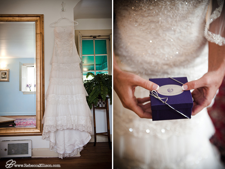Tiered lace wedding dress hangs at the MonteVilla Farmhouse photographed by Bothell wedding photographer Rebecca Ellison