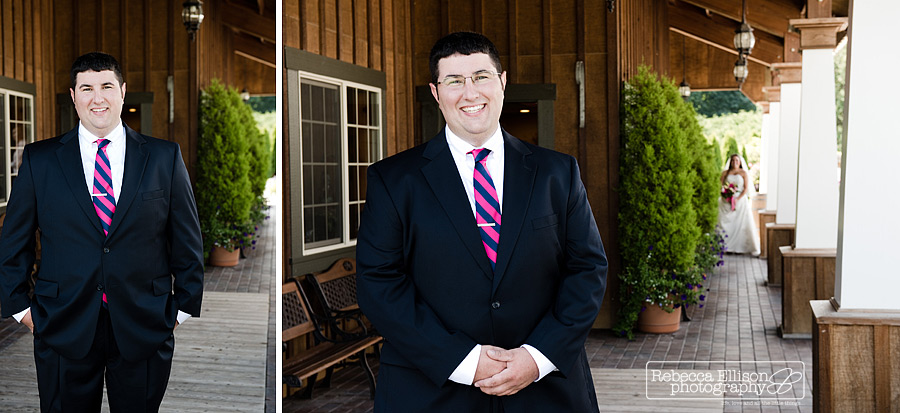 groom waits for his bride during first look portraits at Tazer Valley Farm featuring pink and blue necktie photographed by Snohomish wedding photographer Rebecca Ellison