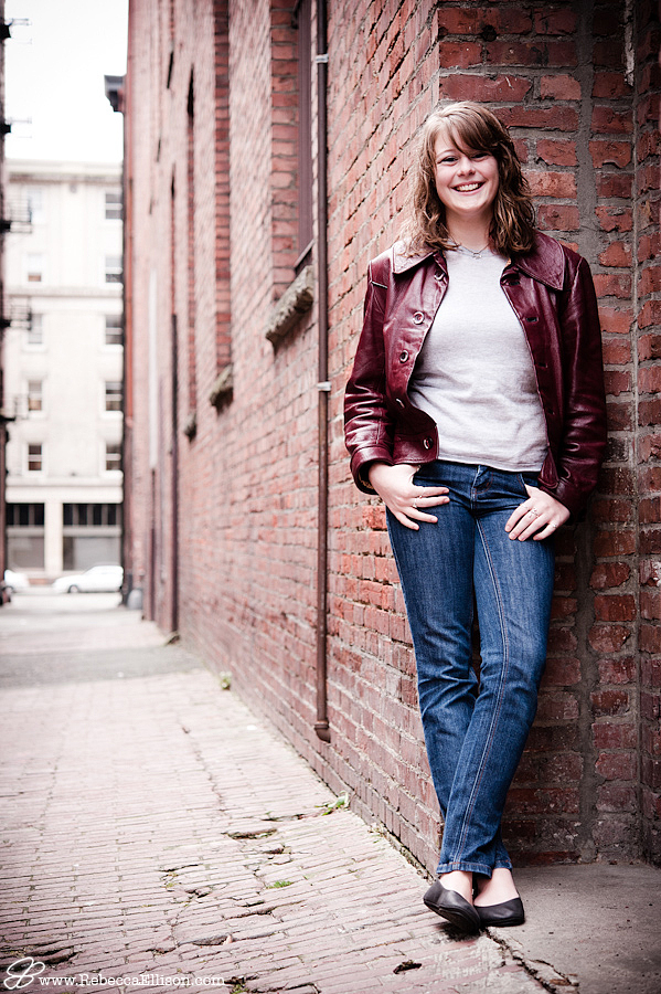 Outdoor senior photos in the urban setting of Seattle's Pioneer Square photography by Rebecca Ellison