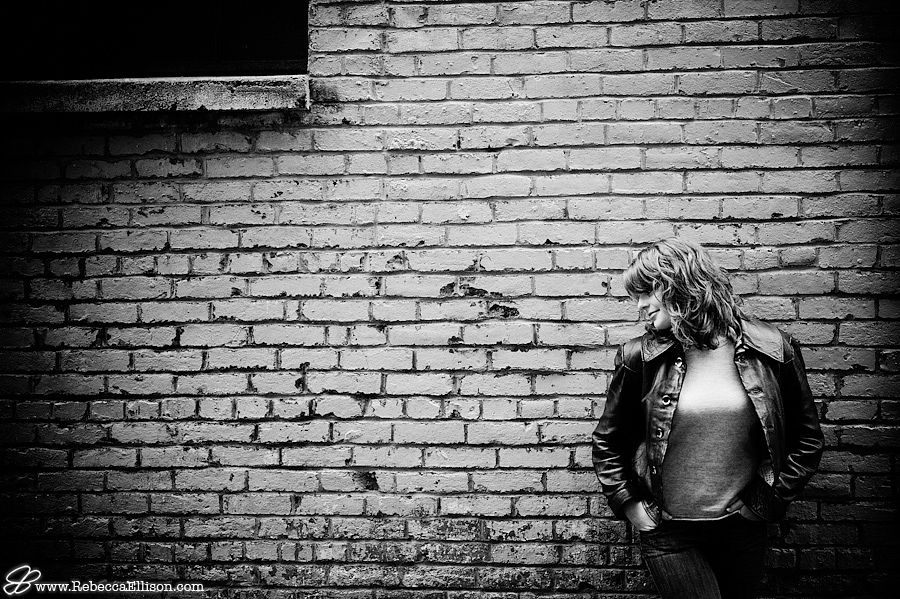 Black and white senior photography in Pioneer Square Leather Jacket and a brick wall