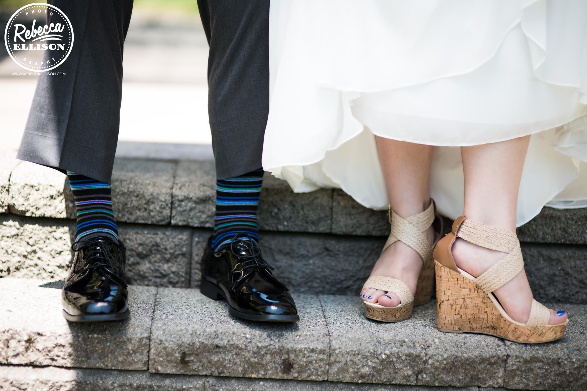 Wedding portraits featuring feet wearing tan cork wedge sandals and striped socks