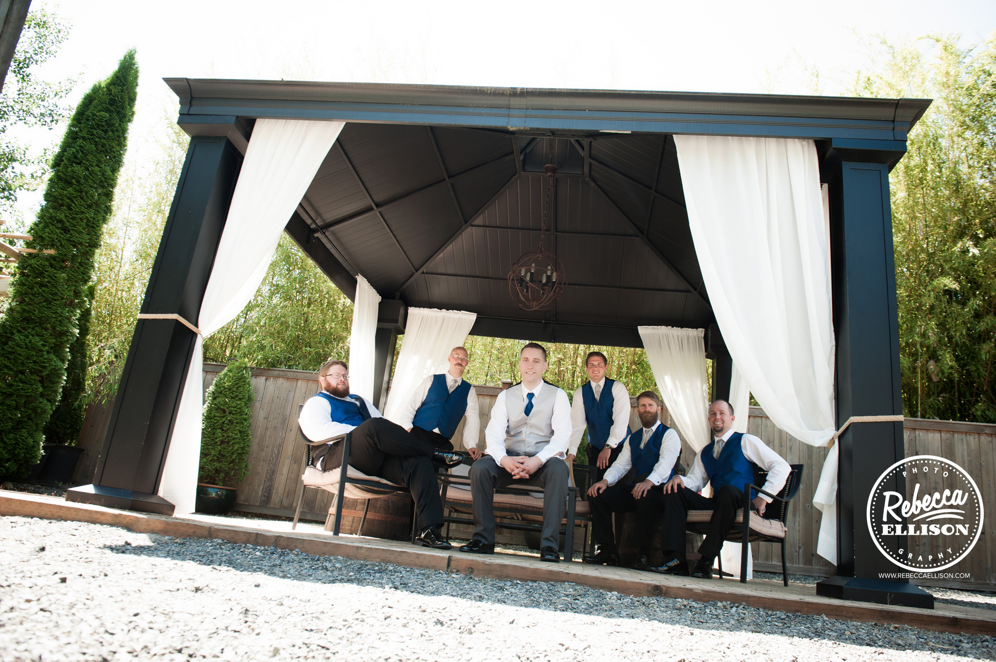 Groom and groomsmen at a peach and blue wedding at Snohomish wedding venue Jardin del sol photography by Rebecca Ellison