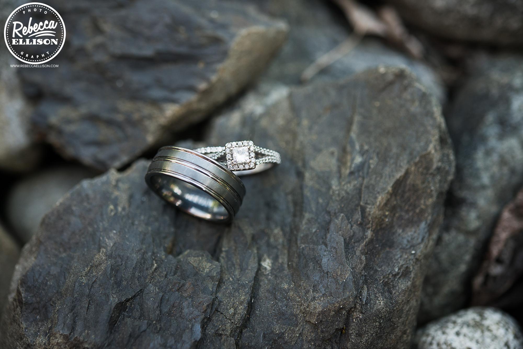 Wedding rings laying on rocks photographed by Seattle wedding photographer Rebecca Ellison