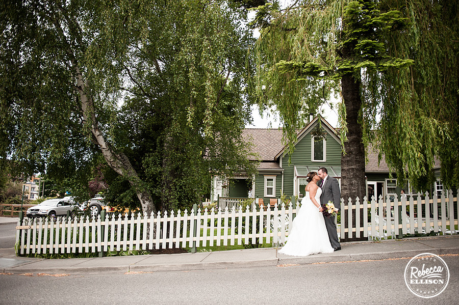 Bride and groom stand in front of the Tucker House Inn for their Friday Harbor Wedding photographed by Rebecca Ellison Photography