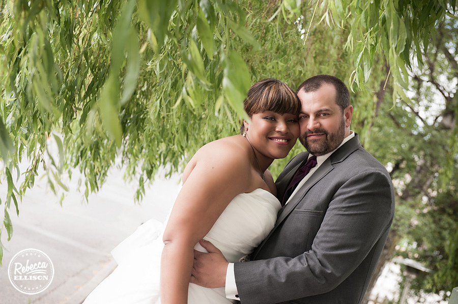 Bride and groom stand under a weeping willow in Friday Harbor for their intimate hotel wedding at Tucker House Inn photographed by Rebecca Ellison Photography