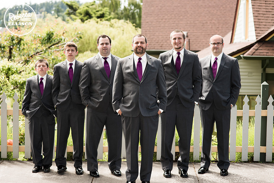 Groom and his groomsmen during outdoor wedding photos at Tucker House Inn in Friday Harbor formalwear by Formals & Frills photographed by Seattle wedding photographer Rebecca Ellison