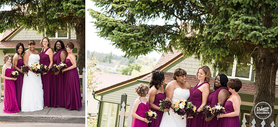 Bride and her bridesmaids in front of the Tucker House Inn in Friday harbor featuring a white strapless wedding dress by Lainee Meg Bridal and plum colored bridesmaids dresses by Nordstrom photographed by Rebecca Ellison Photography