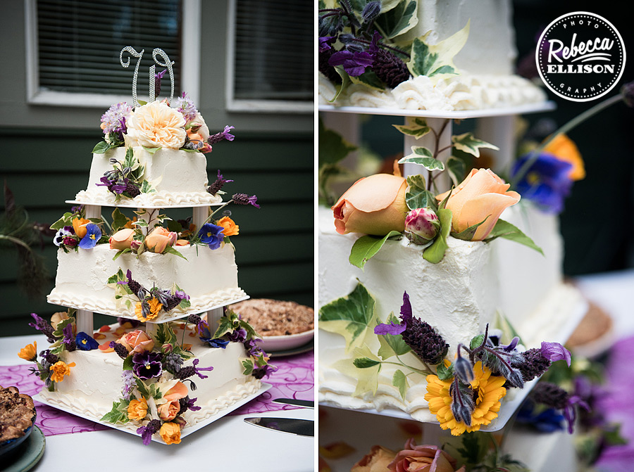 Weddingcake featuring Purple and yellow flowers on a tiered cake stand photographed by Seattle wedding photographer Rebecca Ellison