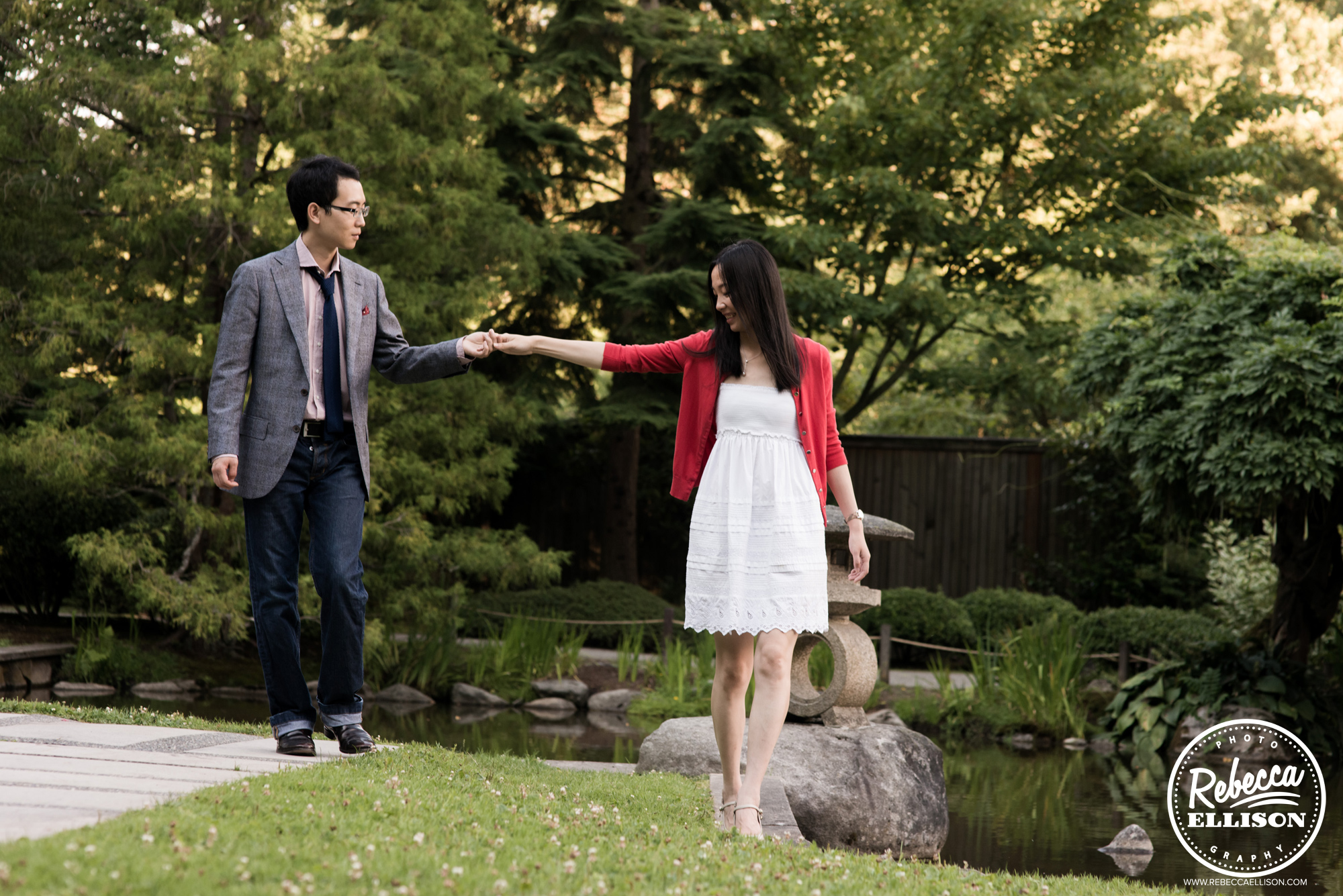 Engaged couple strolls through the Japanese Gardens at University of Washington during their outdoor engagement portraits photographed by University of Washington engagement photographer Rebecca Ellison