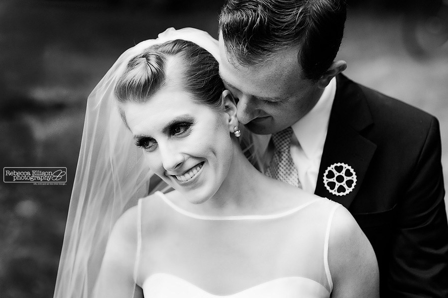Black and white couples portrait of the bride and groom at their backyard wedding photographed by Rebecca Ellison Photography