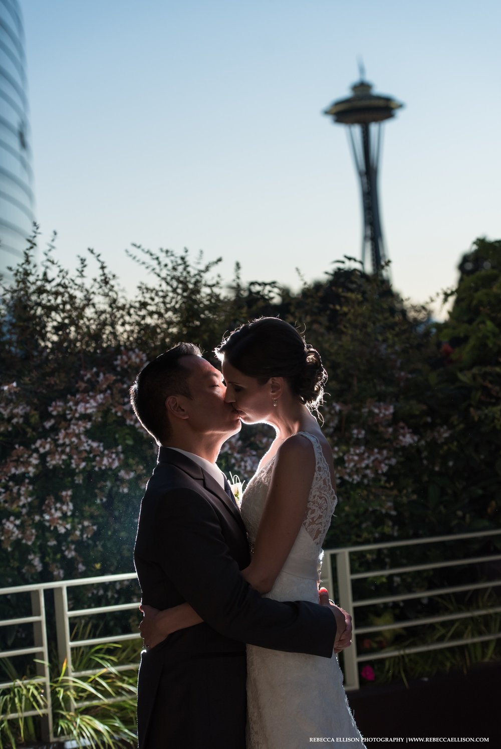 sunset wedding portrait with space needle from pan pacific hotel