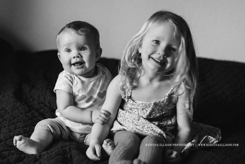 Seattle family photographer capturing an adorable 7 month old baby and her sister and cousins in this at home family photography session