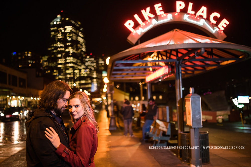 Winter night time engagement photos at Pike Place Market and in unexpected productions Improv theater in downtown Seattle.
