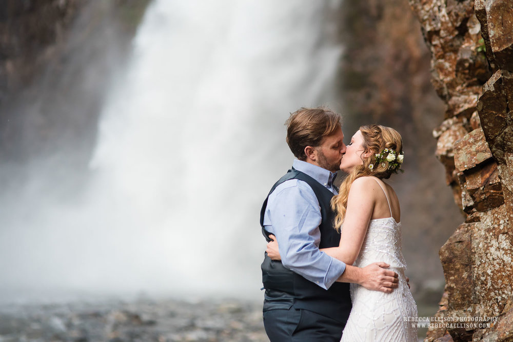 bride and groom at Franklin Falls waterfall