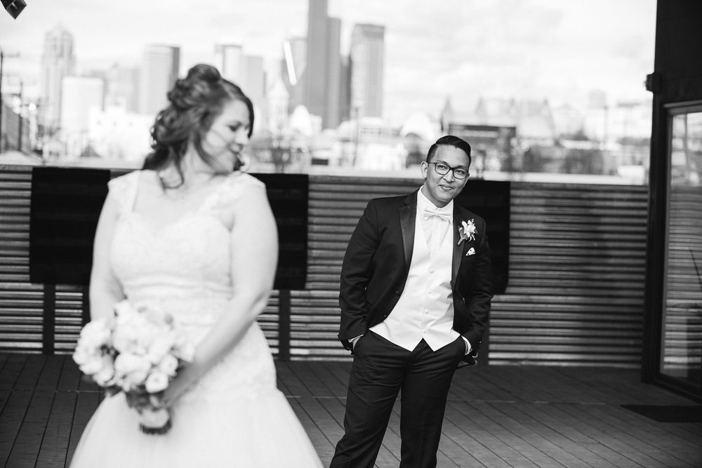 A spring Seattle wedding of yellows and blacks at Within Sodo with Karaoke .