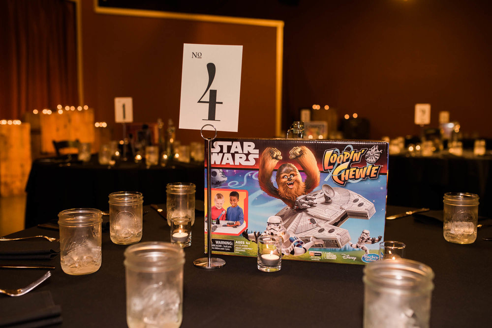 Georgetown Ballroom Wedding with board games, pop culture details and a purple wedding dress.  Wedding centerpiece idea alternative of board games for your guests