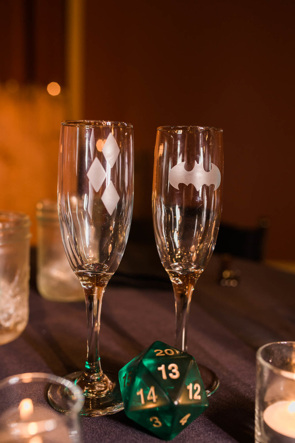 Georgetown Ballroom Wedding with board games, pop culture details and a purple wedding dress.  Champagne wedding glasses for bride and groom with batman and harley quinn logo