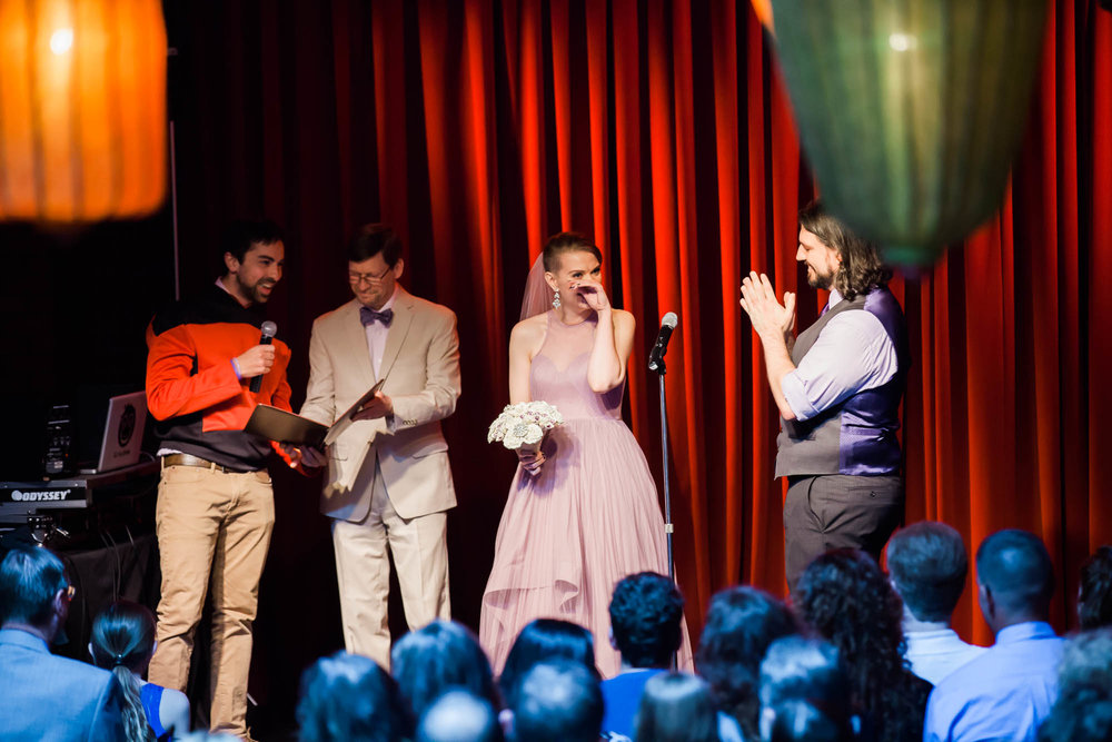 Georgetown Ballroom Wedding with board games, pop culture details and a purple wedding dress.  Star trek red shirt reading for your wedding ceremony