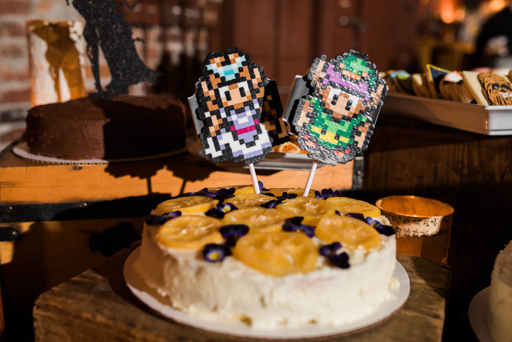 Georgetown Ballroom Wedding with board games, pop culture details and a purple wedding dress.     Zelda and Linc wedding cake toppers