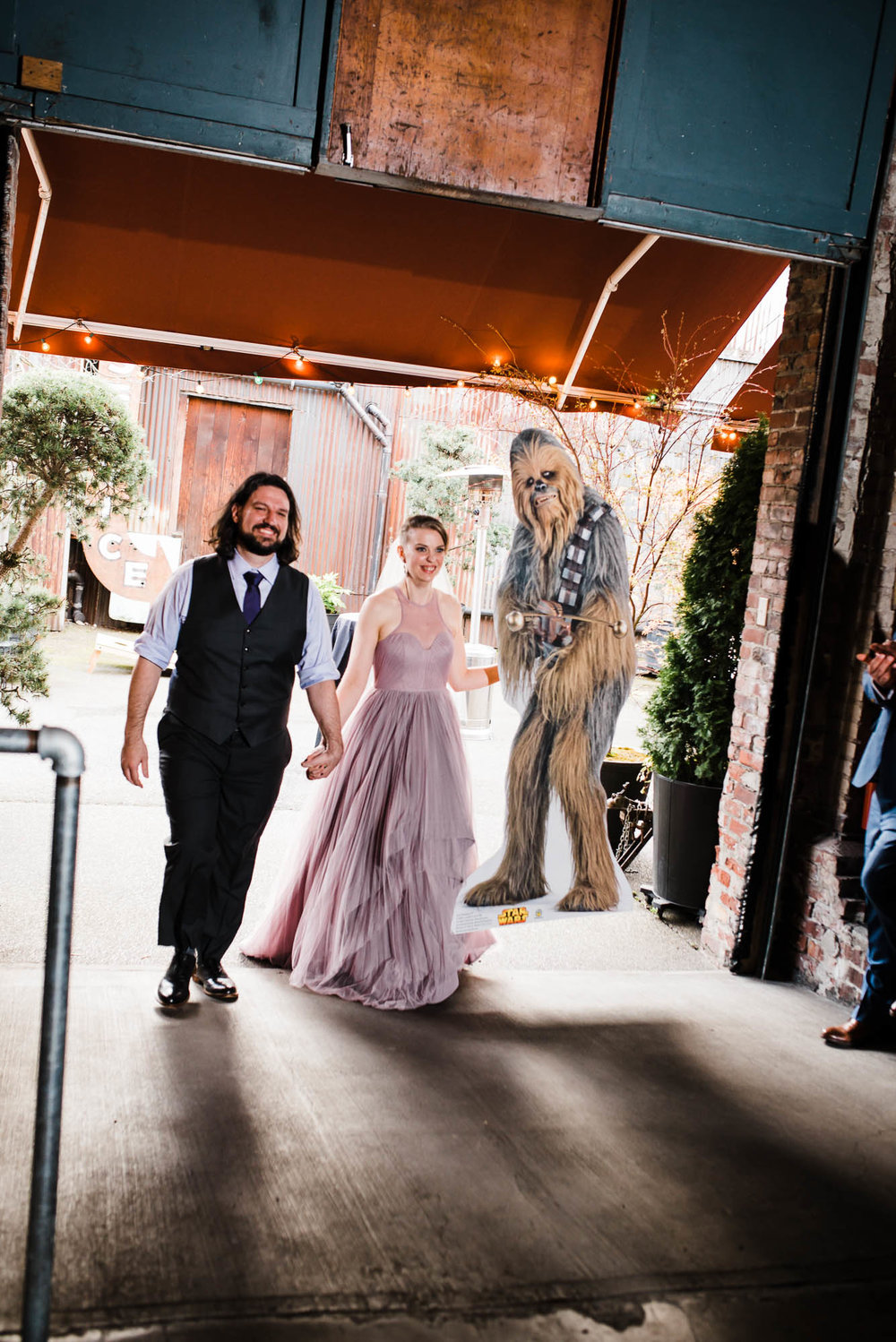 Georgetown Ballroom Wedding with board games, pop culture details and a purple wedding dress.  Grand entrance to wedding reception with chewbacca cardboard cut out
