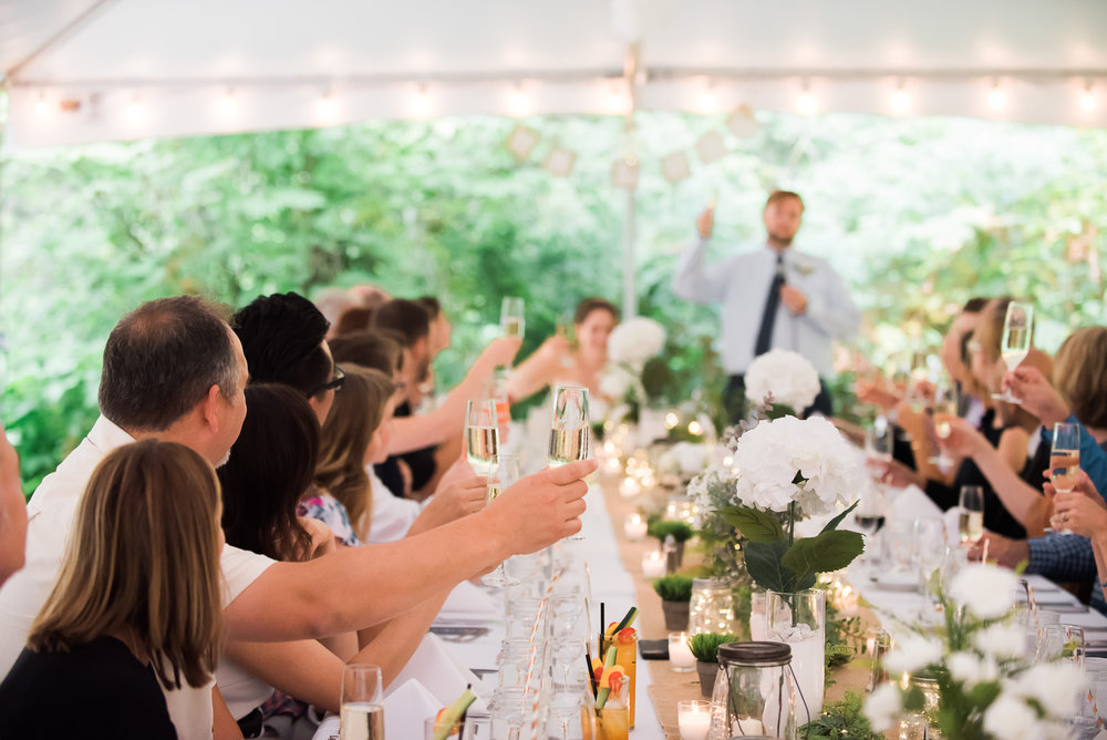 wedding reception cheers clinking glasses Unique PNW wedding venue - Treehouse Point