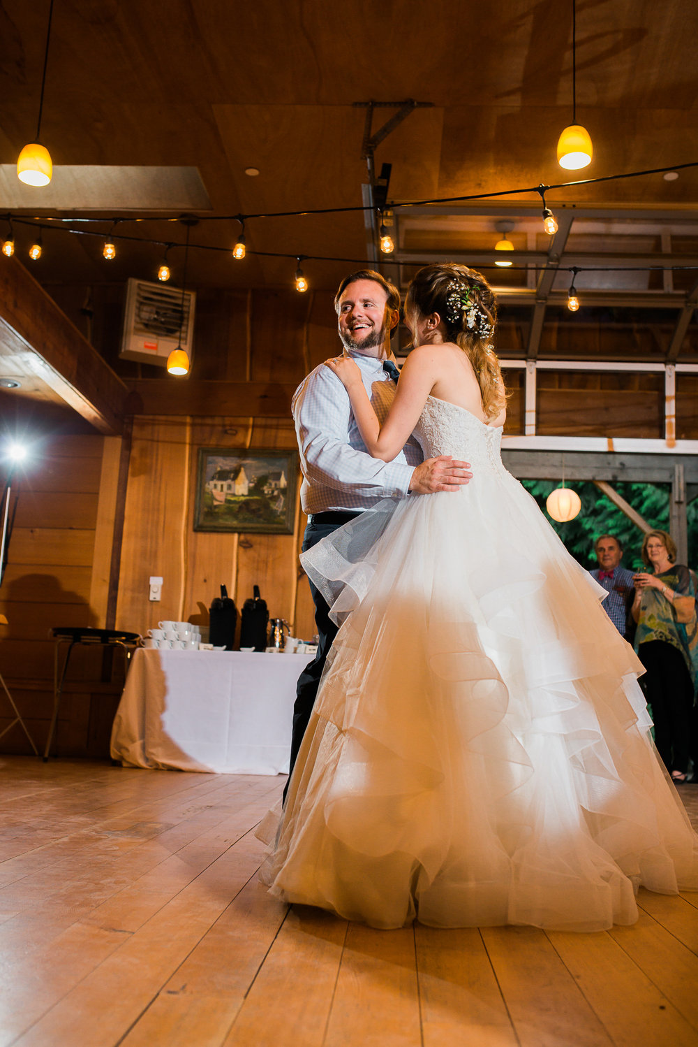 couples first dance in barn at Unique PNW wedding venue - Treehouse Point