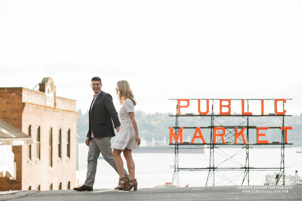 Late afternoon engagement photos at Pike Place Market in Seattle during golden hour of light.