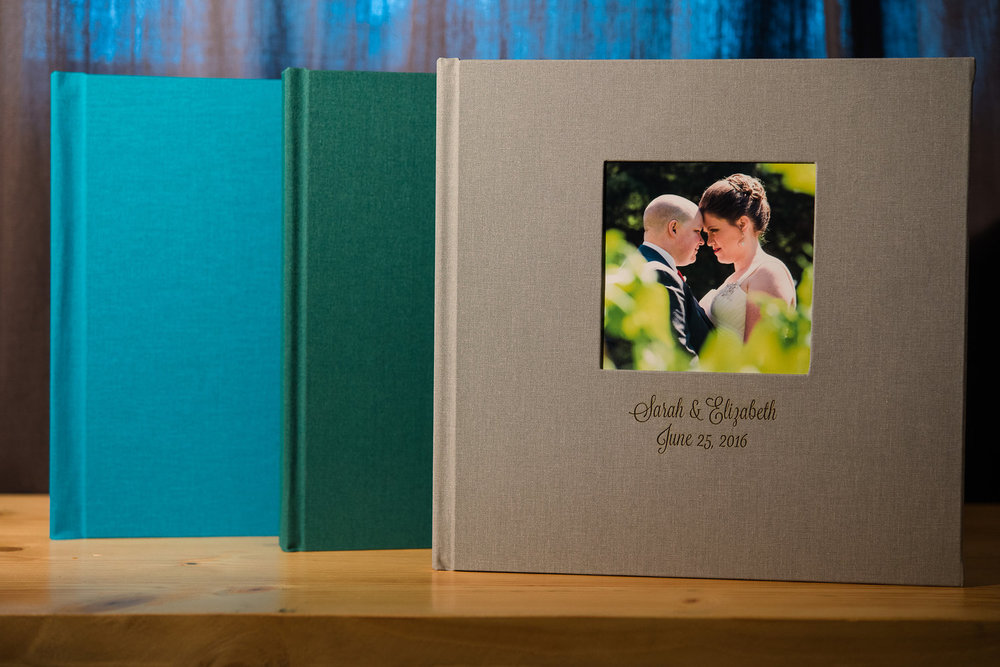 Flush mount wedding albums custom made and embossed with your name and wedding date