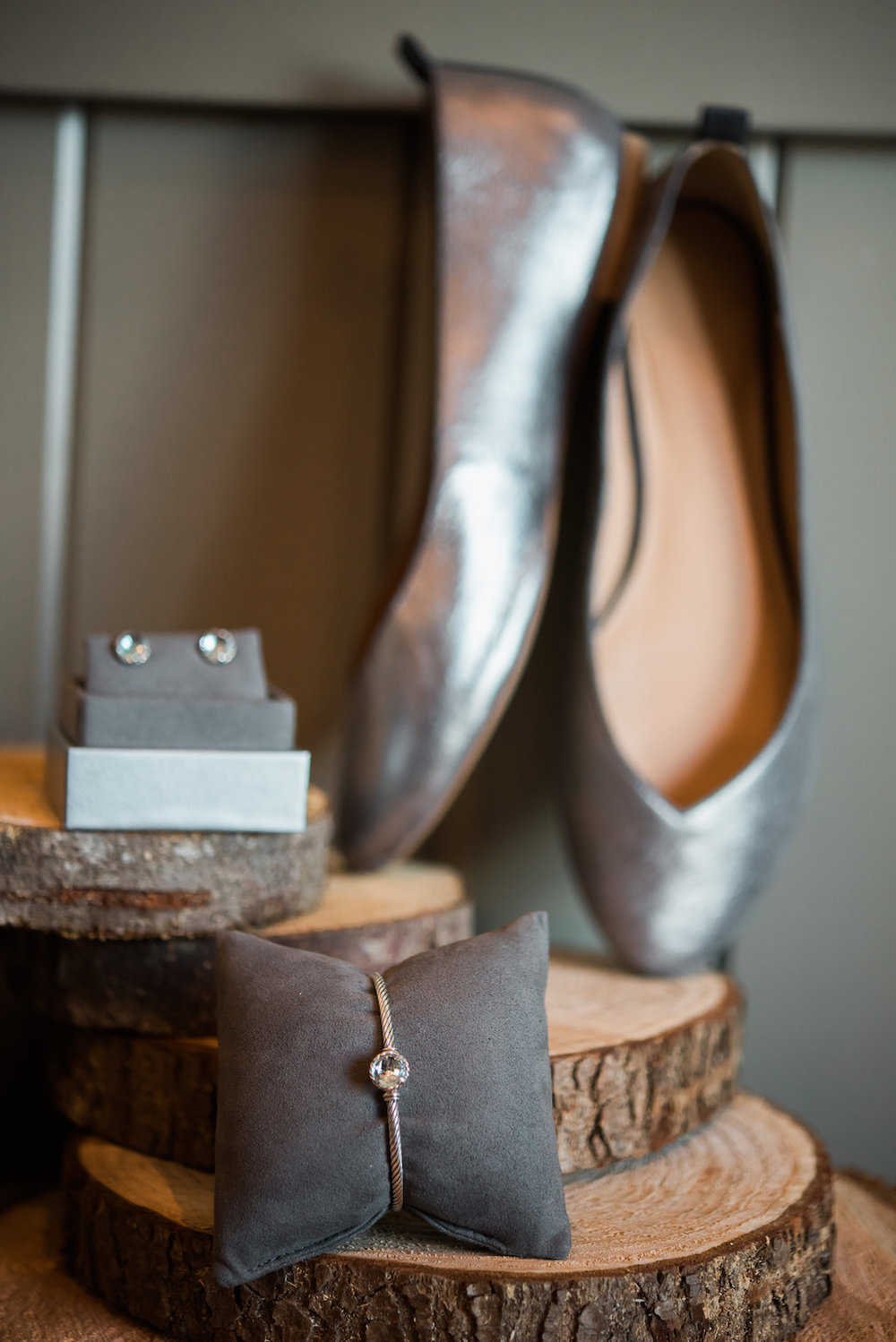 Detail shot of jewelry and shoes on rustic wood at Woodland Park Zoo Wedding photographed by Seattle Wedding Photographer Rebecca Ellison Photography. www.RebeccaEllison.com