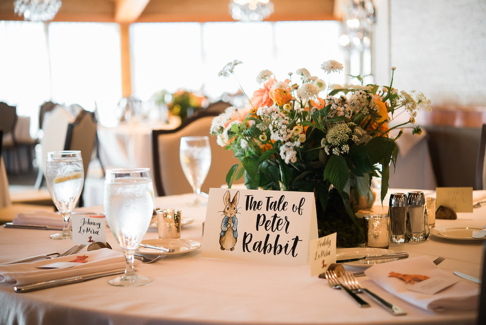 The tale of peter rabbit themed table at an Edgewater wedding reception photographed by Seattle Wedding Photographer Rebecca Ellison Photography. www.RebeccaEllison.com