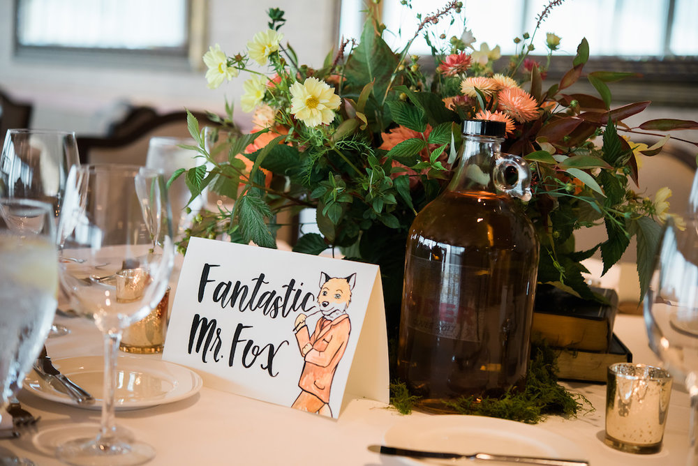Fantastic Mr. fox themed table at an Edgewater Wedding reception photographed by Seattle Wedding Photographer Rebecca Ellison Photography. www.RebeccaEllison.com