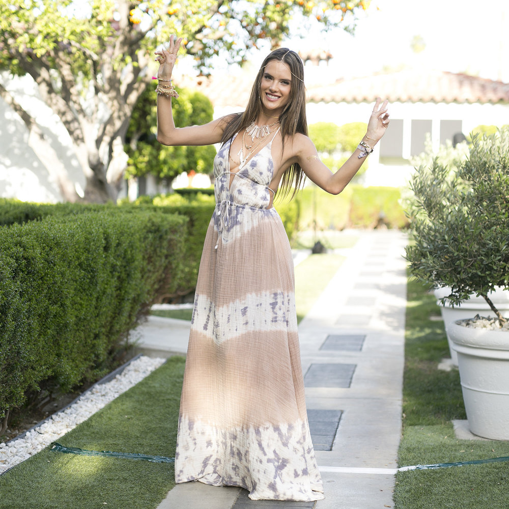 Alessandra Ambrosio in her tie-dye maxi dress with layers of lovely necklaces.Image Source: Pop Sugar
