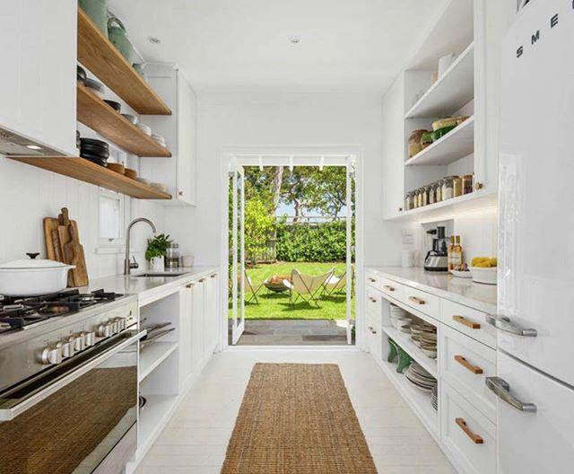 My kitchen 💚 looking onto the garden #simple #pantry #jars #healthy #natural #zerowastegoals #Smeg #Glem #recycledtimber #Ironwood #Auburnwoodturning #natural #white #myhappyplace
