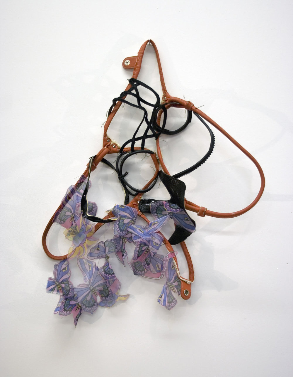 "Sara Hubbs, How High Can You Go? discarded shoes, purse, fabric, & thread, approximately 25"" x 18"" x 6"""