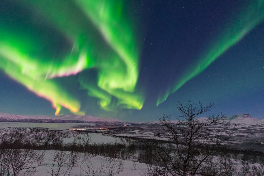 Extremely strong auroral display above the village of Abisko.
