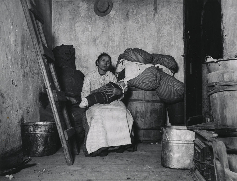 In_the_Home_of_an_Italian_Rag-Picker,_Jersey_Street.jpg