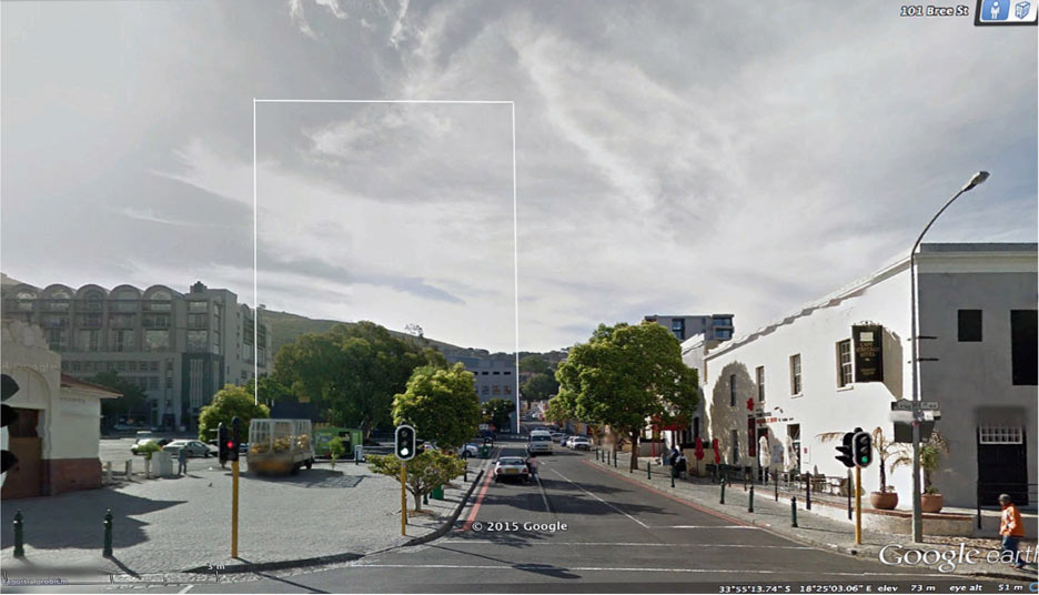 Street-level view from the eastern corner of Riebeeck Square (101 Bree Street) looking westwards towards the site of the proposed ±20 storey building development (the approximate outline-massing of the elevation of the building is shown in white outline, without the small proposed set- backs from about 38m up) with the ±10 storey Studios Building appearing to the left and the 2-3 storey Heritage Square to the right: (courtesy GoogleEarth Streetview).