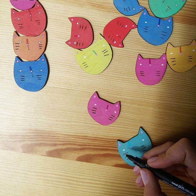 A productive day today at @brickandmortarcreative, adding sweet little faces to a batch of #kittybrooches. 🎨 #handmade #brooch #wood #adelaide #studio #shoplocal