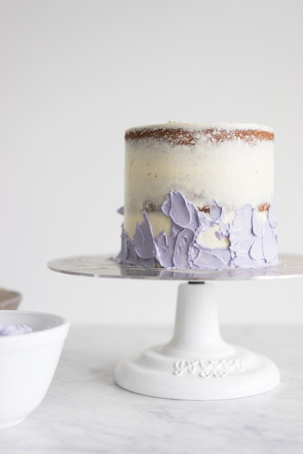Honey lavender cake with vanilla german buttercream and lavender chocolate ganache drip