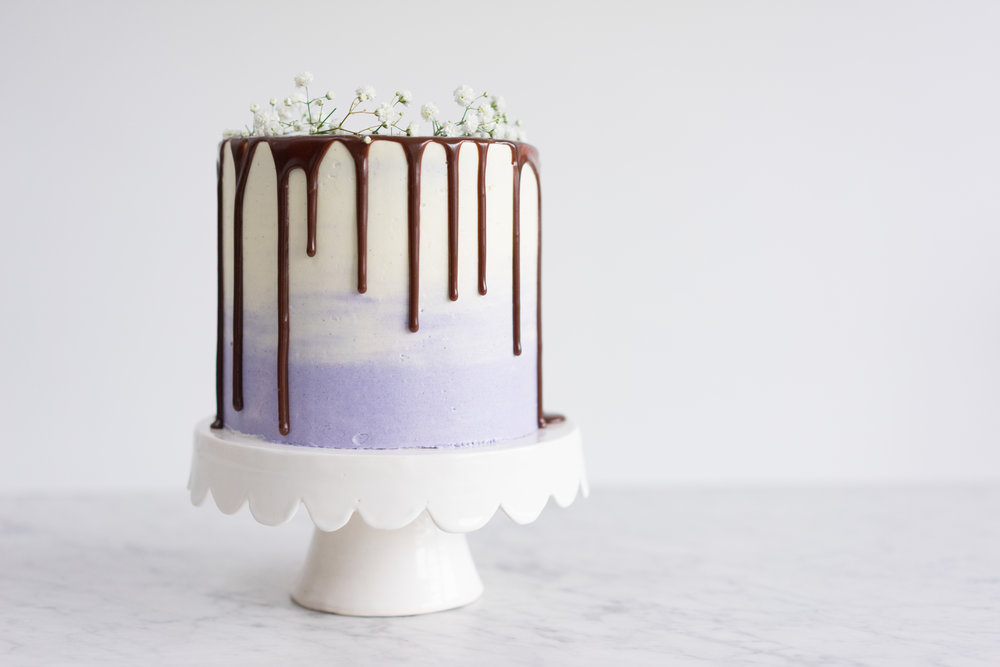Honey lavender cake with vanilla german buttercream and lavender milk chocolate ganache drip
