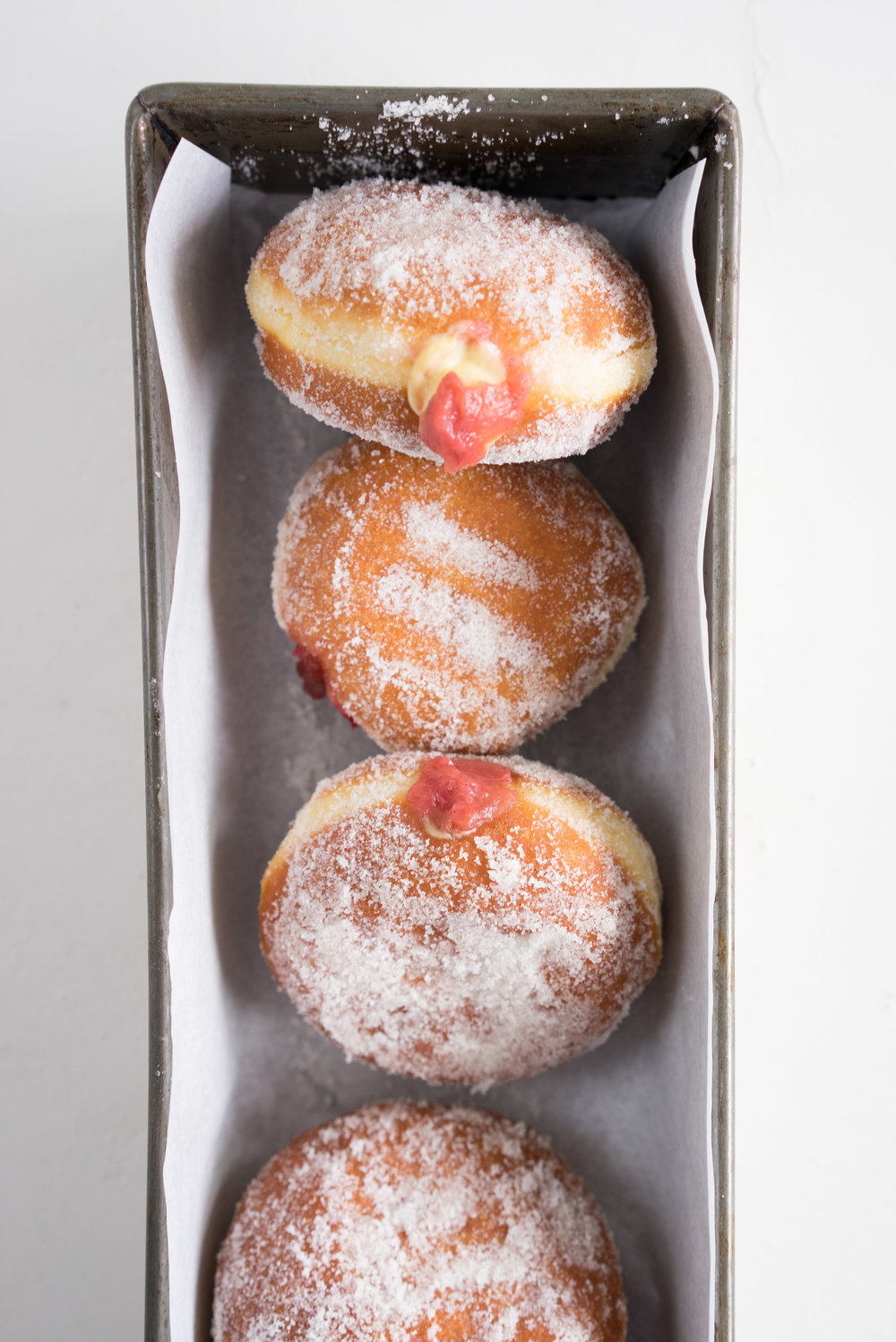 Brioche doughnuts, roasted rhubarb, vanilla bean pastry cream, and vanilla sugar