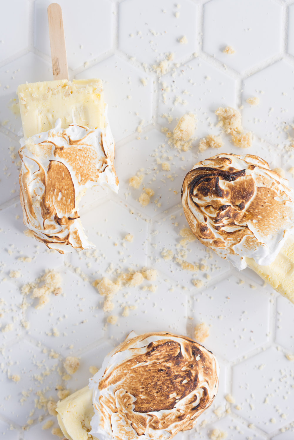 Lemon Meringue pie ice cream pops - if pie and ice cream had a baby, this would be it. The perfect combination of punchy lemon curd ice cream, pie crumb, and toasty meringue.