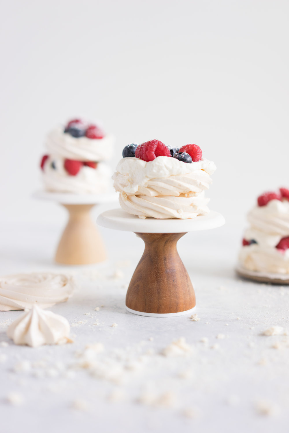Meringue stacks with vanilla bean mascarpone whipped cream and fresh berries