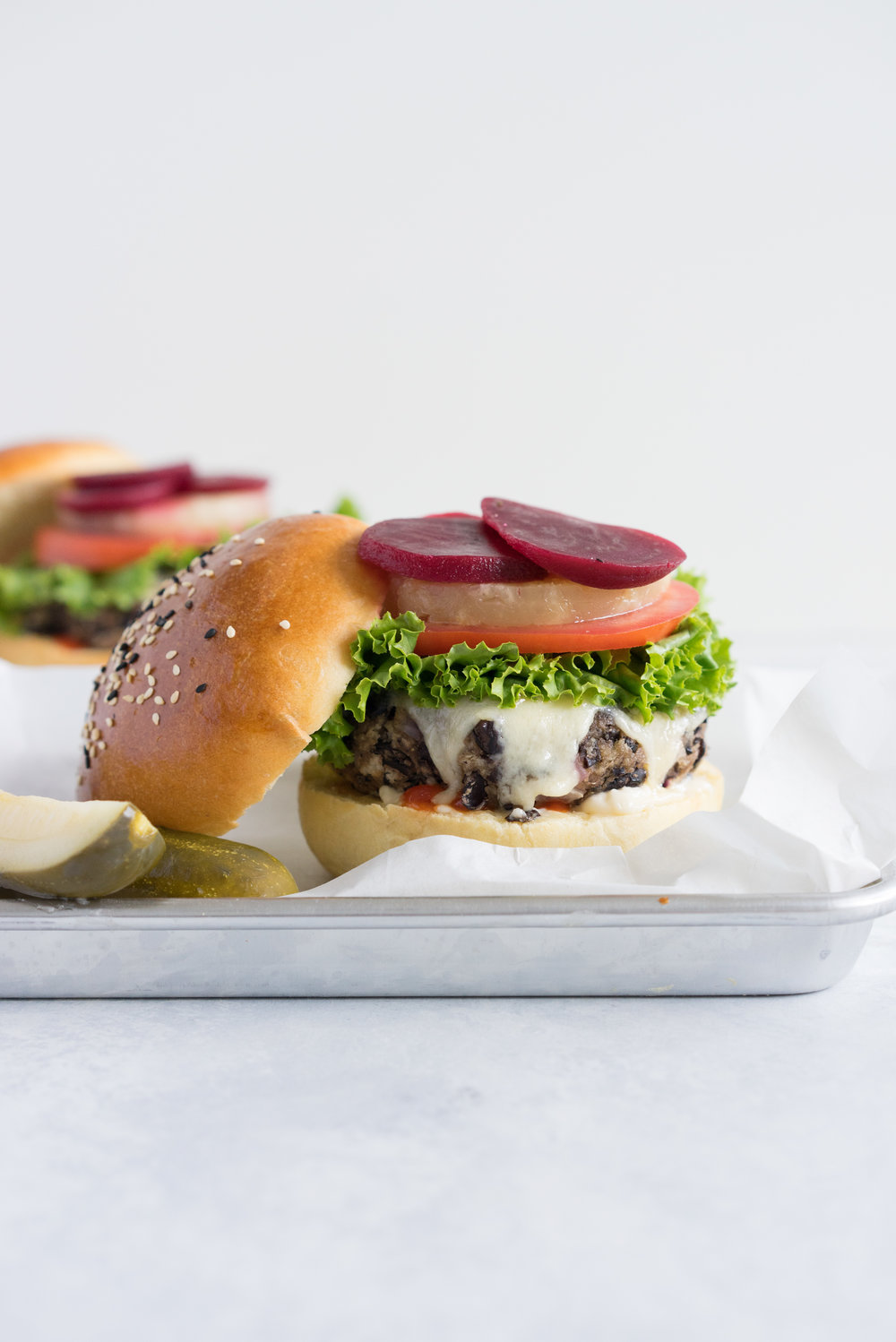 Black bean burgers with homemade brioche burger buns - the perfect vegetarian meal that even the staunchest of hamburger eater will love! #vegetarian #blackbeanburger