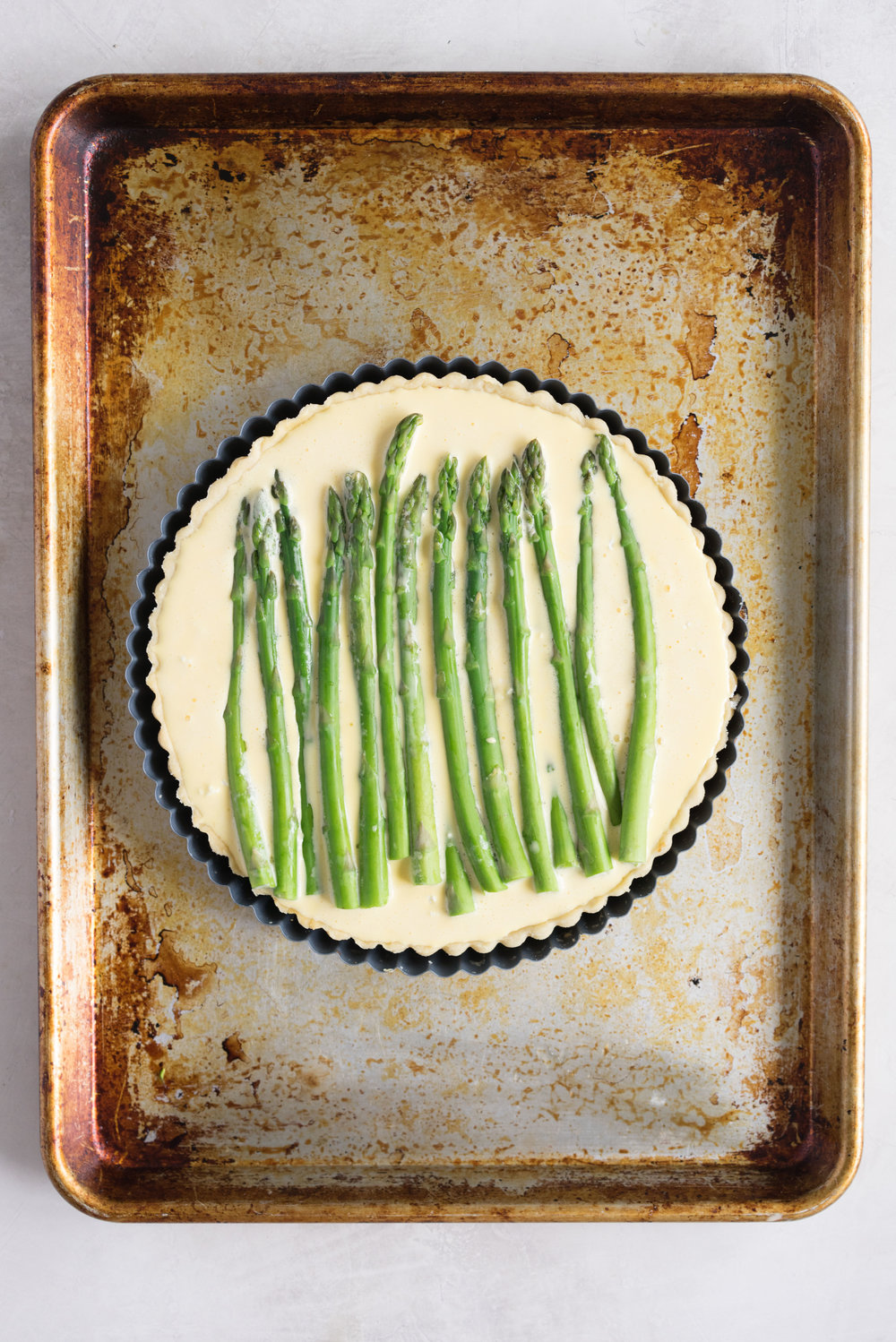 Asparagus, Goat Cheese, and Caramelised Onion Quiche - a great way to use up bits and bobs in your fridge. Would also be great with broccoli!