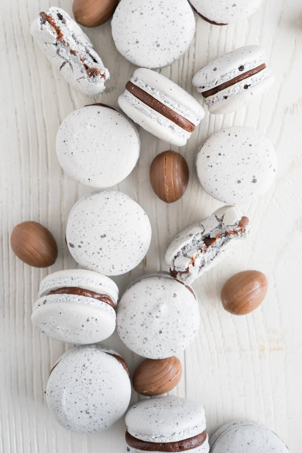 Creme egg macarons - a favourite easter treat, transformed into a macaron. A speckled vanilla bean shell is sandwiched with a rich creme egg ganache