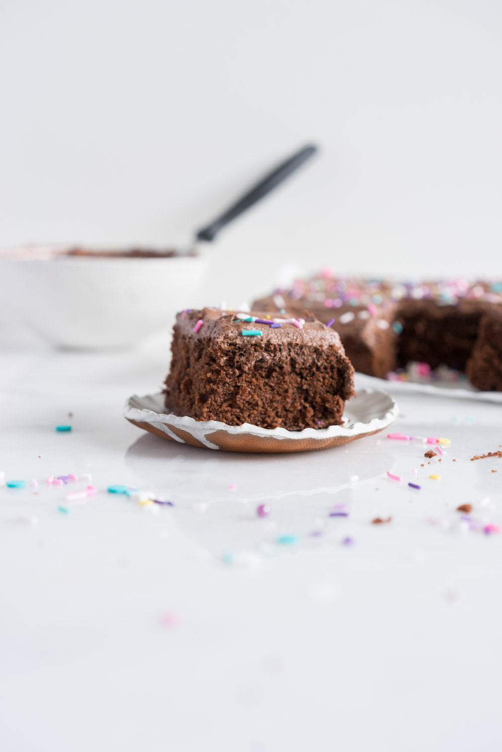 Chocolate Snack Cake with Chocolate Buttercream - the perfect cake recipe to have in your back pocket. Tender chocolate cake topped with fluffy chocolate buttercream #chocolatecake #snackcake