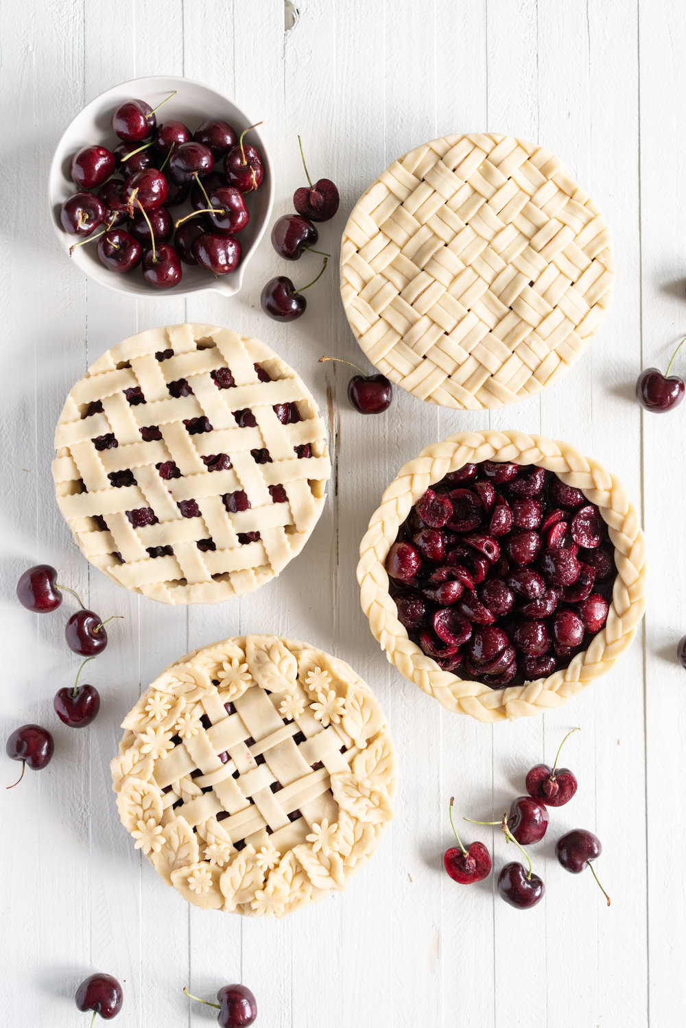When you have beautiful, in season cherries, it really is a shame to do anything with it other than make Cherry Pie! These cherry pies are perfectly juicy, with the right balance of sweetness, and have a tender, flaky crust. They are easy to make, can be prepared ahead, and make the perfect summer dessert. #pie #cherrypie #recipe #darkcherrypie #fruitpie